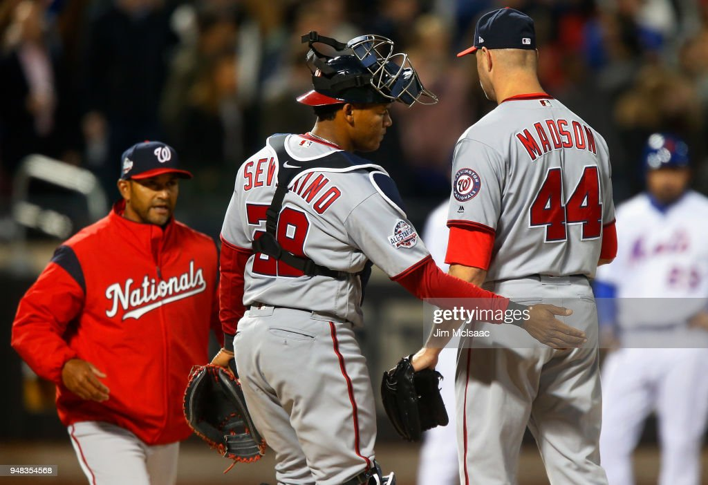 Ryan Madson #44 of the Washington Nationals is removed from a game in the eighth inning against the New York Mets by manager Dave Martinez #4 at Citi Field on April 18, 2018 in the Flushing neighborhood of the Queens borough of New York City.