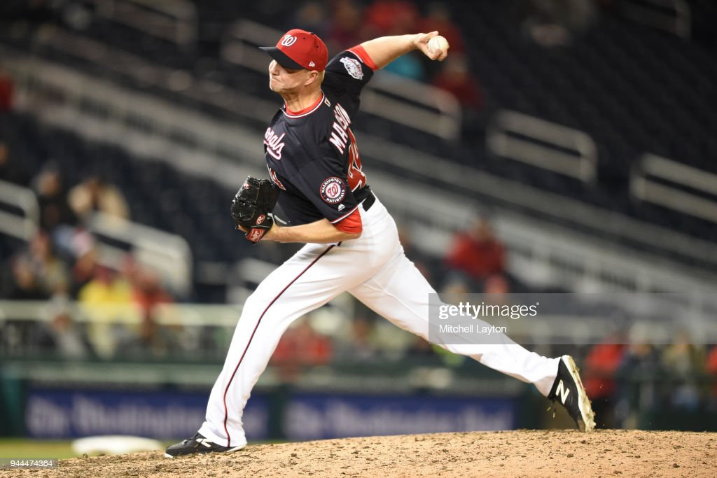 Ryan Madson #44 of the Washington Nationals pitches in the ninth inning for his first save of the year during a baseball game against the Atlanta Braves at Nationals Park on April 10, 2018 in Washington, DC.