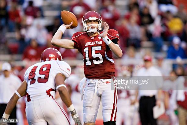 Ryan Mallet of the Arkansas Razorbacks Red team throws a pass during the Spring Red White game at Donald W Reynolds Stadium on April 18 2009 in...