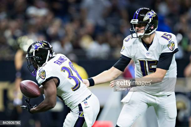 Ryan Mallett hands off the ball to Bobby Rainey of the Baltimore Ravens during a preseason game against the New Orleans Saints at MercedesBenz...