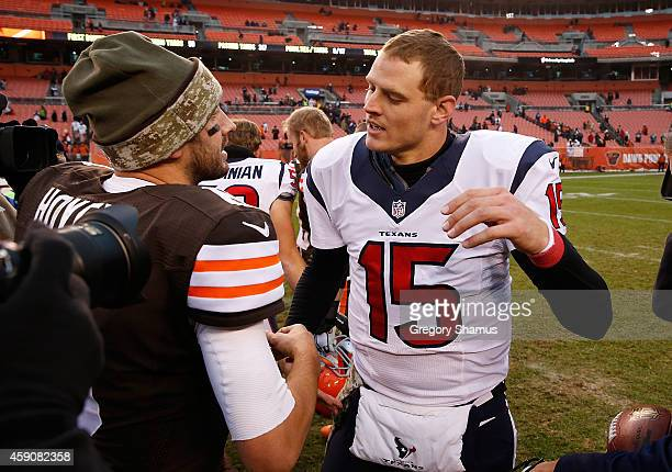 Ryan Mallett of the Houston Texans is congratulated by Brian Hoyer of the Cleveland Browns after Houston's 237 win at FirstEnergy Stadium on November...