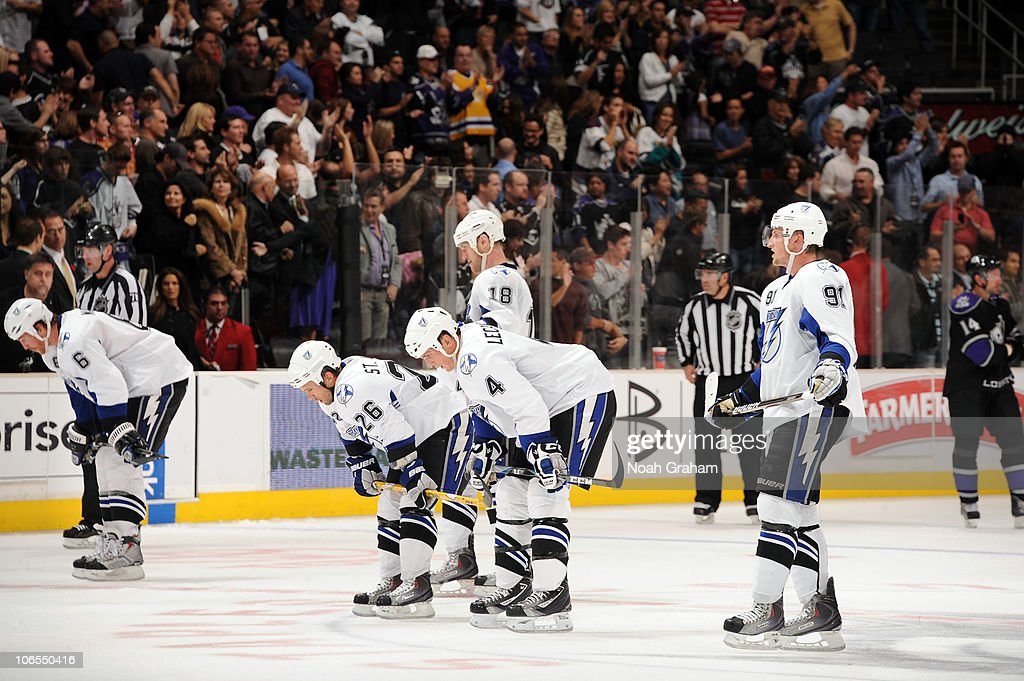 Ryan Malone #6, Martin St Louis #26, Adam Hall #18, Vincent Lecavalier #4 and Steven Stamkos #91 of of the Tampa Bay Lightning skate off the ice after losing to the Los Angeles Kings at Staples Center on November 4, 2010 in Los Angeles, California.