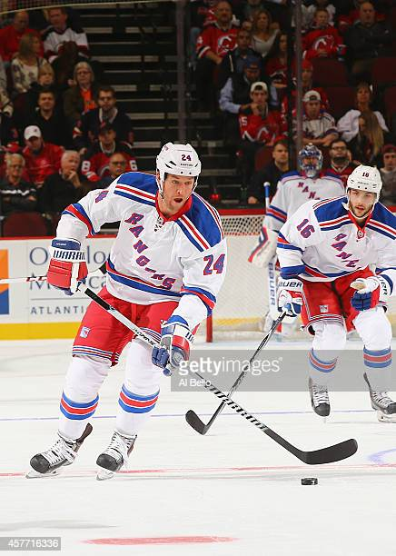 Ryan Malone of the New York Rangers in action against the New Jersey Devils during their game at the Prudential Center on October 21 2014 in Newark...