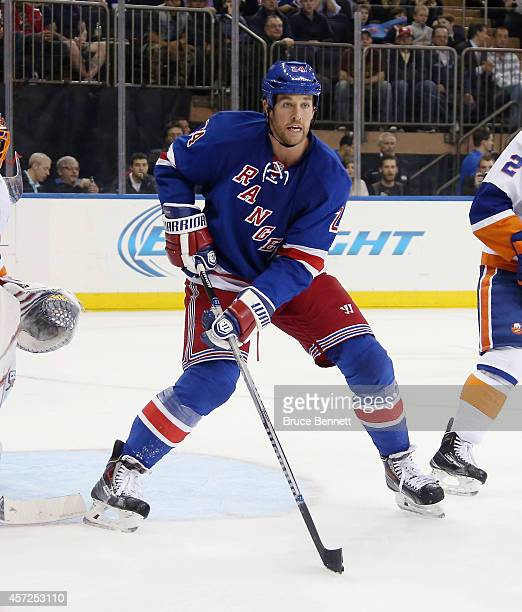 Ryan Malone of the New York Rangers skates against the New York Islanders at Madison Square Garden on October 14 2014 in New York City The Islanders...