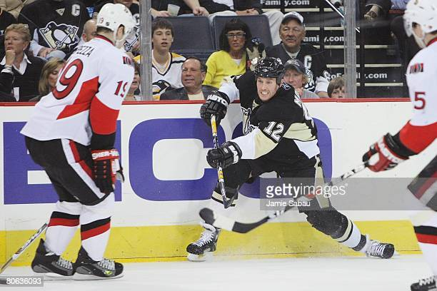 Ryan Malone of the Pittsburgh Penguins shoots the puck past Jason Spezza of the Ottawa Senators during game one of the Eastern Conference...
