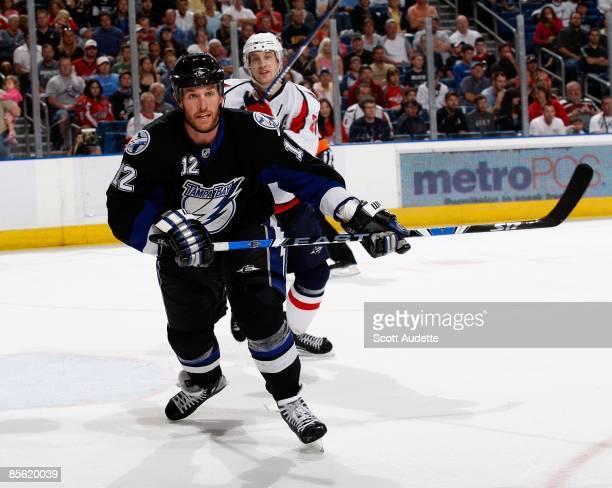 Ryan Malone of the Tampa Bay Lightning races to the puck against the Washington Capitals at the St Pete Times Forum on March 19 2009 in Tampa Florida