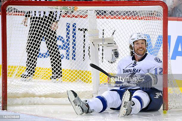 Ryan Malone of the Tampa Bay Lightning reacts after crashing the net during the NHL game against the Montreal Canadiens at the Bell Centre on April 4...