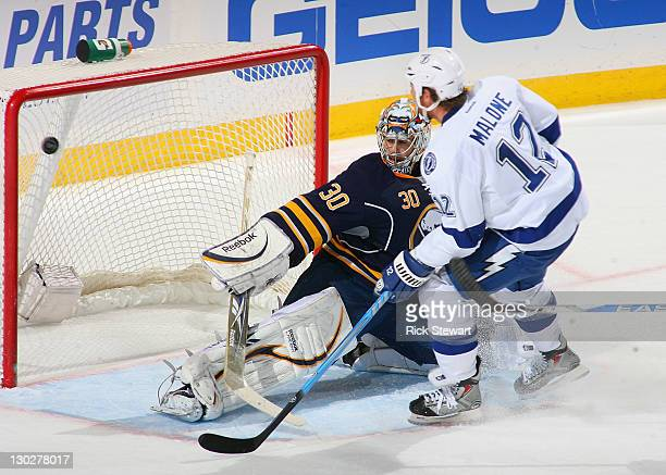 Ryan Malone of the Tampa Bay Lightning scores the gamewinning goal on Ryan Miller of the Buffalo Sabres late in the third period at First Niagara...