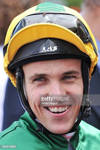 Ryan Maloney after winning aboard Girl in Flight in Race 2 the Leigh Thomas Gift during racing at Caulfield Racecourse on November 30 2013 in...