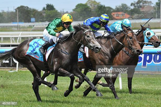 Ryan Maloney riding Girl in Flight winning Race 2 the Leigh Thomas Gift during racing at Caulfield Racecourse on November 30 2013 in Melbourne...