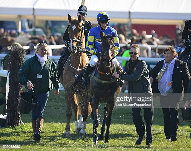 Ryan Mania and Auroras Encore are lead home after winning the John Smith's Grand National Chase on the 3rd day of the 2013 Grand National meeting at...