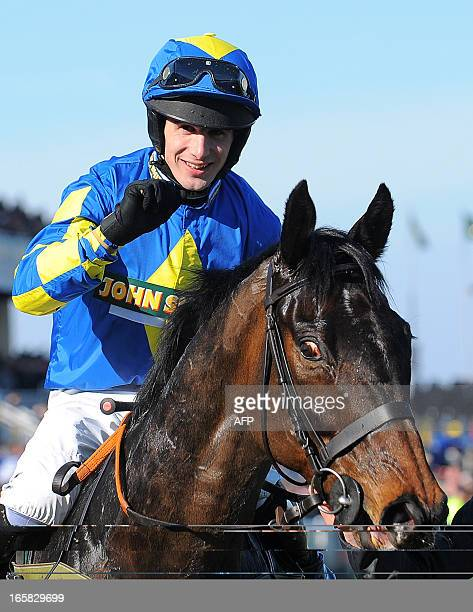 Ryan Mania on Auroras Encore celebrates after winning the Grand National horse race at Aintree Racecourse in Liverpool, north-west England, on April...