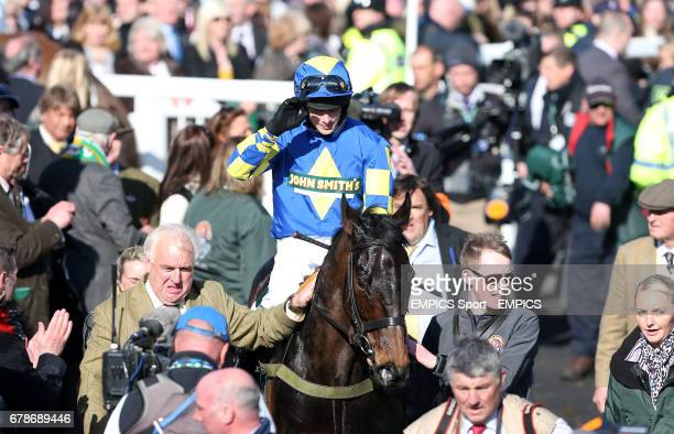 Ryan Mania returns to the winning enclosure on Auroras Encore after winning the John Smiths' Grand National Steeple Chase during Grand National Day...