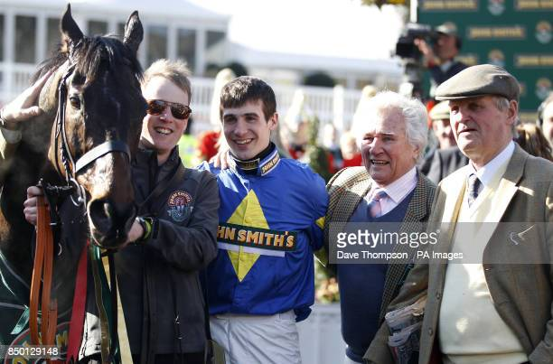 Ryan Mania returns to the winning enclosure with Auroras Encore after winning the John Smiths' Grand National Steeple Chase during Grand National Day...