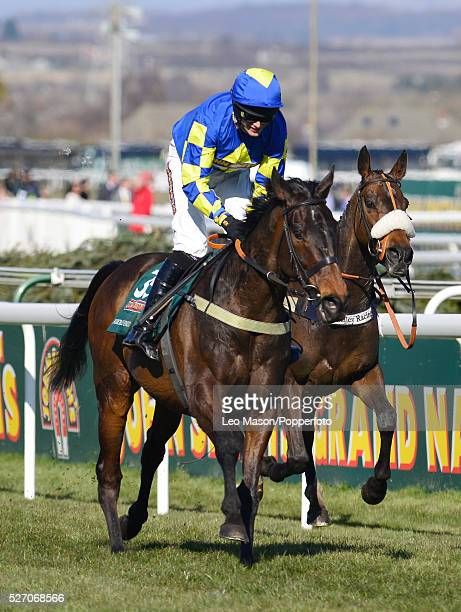 Ryan Mania rides Auroras Encore to win the John Smith's Grand National Chase on the 3rd day of the 2013 Grand National meeting at Aintree racecourse...
