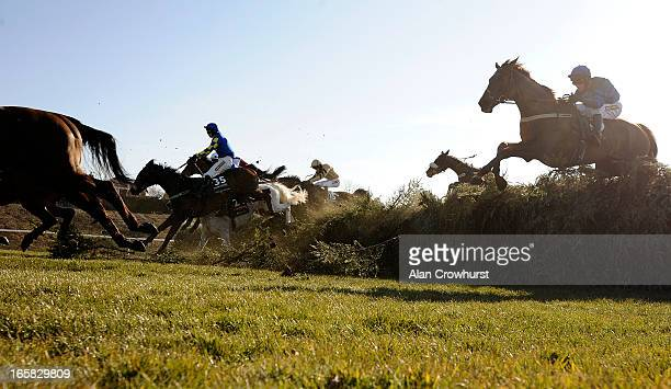 Ryan Mania riding Auroras Encore clear the 19th fence on their way to winning The John Smith's Grand National Steeple Chase at Aintree racecourse on...