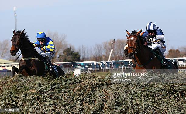 Ryan Mania riding Auroras Encore clears the last fence ahead of Teaforthree ridden by Nick Schofield on their way to victory in the John Smiths Grand...