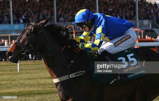 Ryan Mania riding Auroras Encore clears the last fence on their way to victory in the John Smiths Grand National at Aintree Racecourse on April 6,...