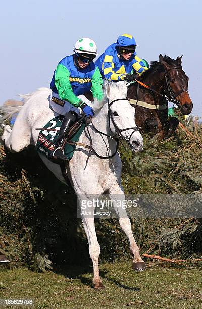 Ryan Mania riding Auroras Encore jump the chair behind Conor O'Farrell riding Swing Bill during the John Smiths Grand National Steeple Chase at...