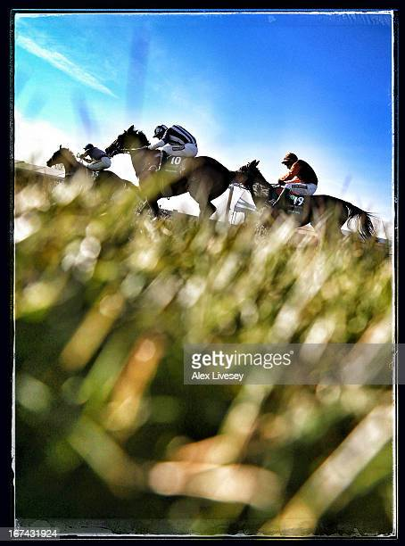 Ryan Mania riding Auroras Encore leads Teaforthree ridden by Nick Schofield on their way to victory in the John Smiths Grand National at Aintree...