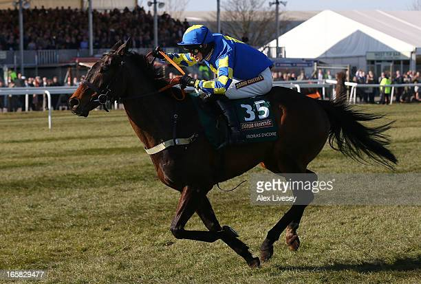Ryan Mania riding Auroras Encore races to win the John Smiths Grand National Steeple Chase at Aintree Racecourse on April 6, 2013 in Liverpool,...