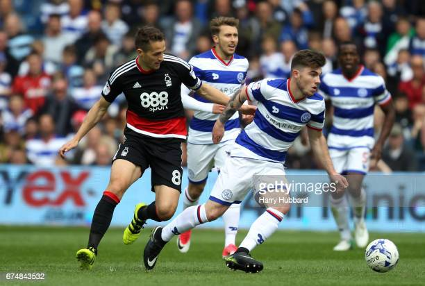 Ryan Manning of QPR and Chris Cohen of Nottingham Forest in action during the Sky Bet Championship match between Queens Park Rangers and Nottingham...