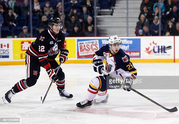 Ryan Mantha of the Niagara IceDogs and Andrew Mangiapane of the Barrie Colts skate during an OHL game at the Meridian Centre on March 19, 2015 in St...