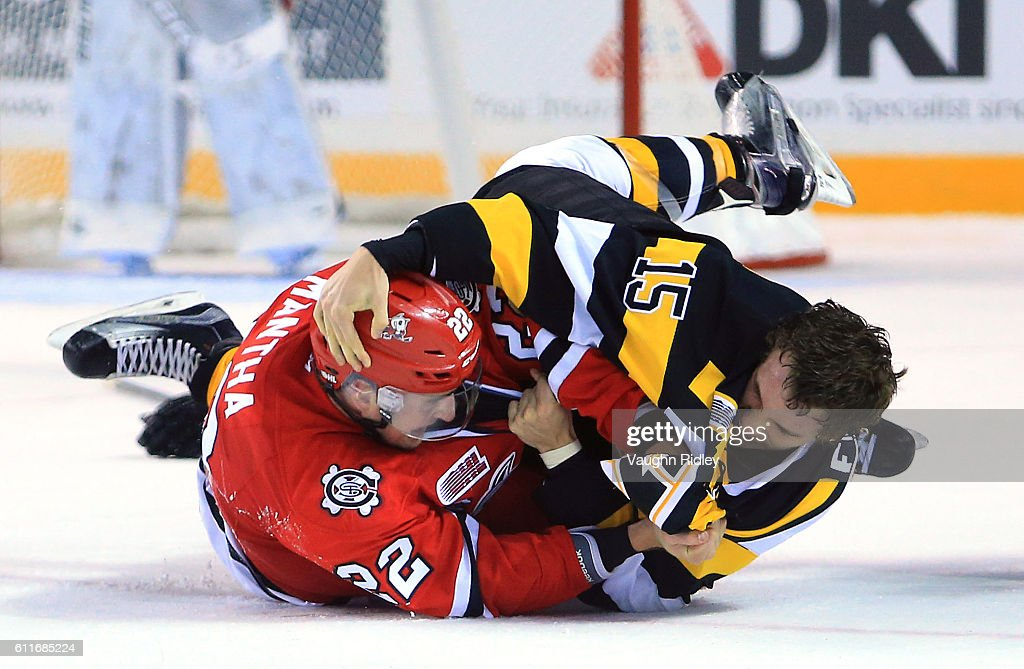 Ryan Mantha #22 of the Niagara IceDogs and Sam Field #15 of the Kingston Frontenacs fight during the second period of an OHL game at the Meridian Centre on September 30, 2016 in St Catharines, Ontario, Canada.