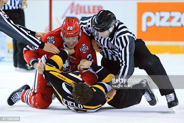 Ryan Mantha of the Niagara IceDogs and Sam Field of the Kingston Frontenacs fight during the second period of an OHL game at the Meridian Centre on...
