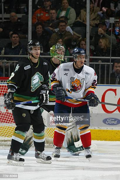 Ryan Martinelli of the London Knights defends against Richard Clune of the Barrie Colts in game played at the John Labatt Centre on December 29 2006...