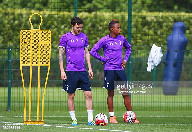 Ryan Mason and Clinton N'Jie look on during a Tottenham Hotspur training session at the Tottenham Hotspur Training Centre on May 12 2016 in Enfield...
