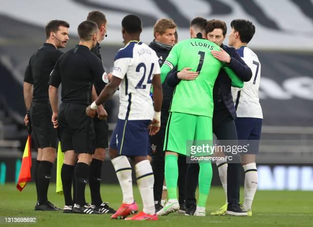 Ryan Mason, Interim head coach of Tottenham Hotspur celebrates victory with Hugo Lloris of Tottenham Hotspur after the Premier League match between...