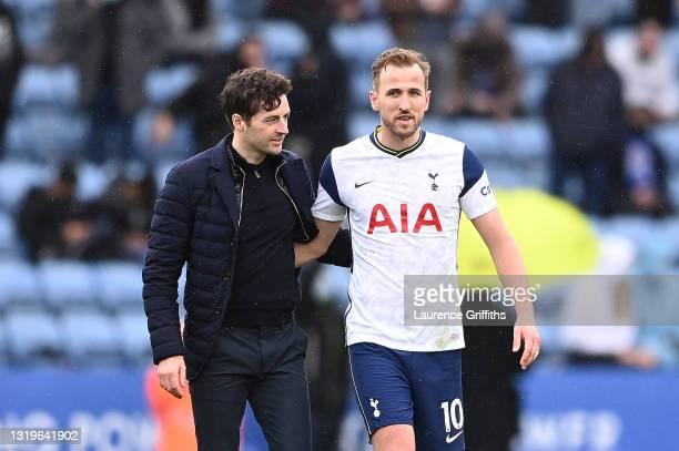 Ryan Mason, Interim Head Coach of Tottenham Hotspur embraces Harry Kane of Tottenham Hotspur following the Premier League match between Leicester...