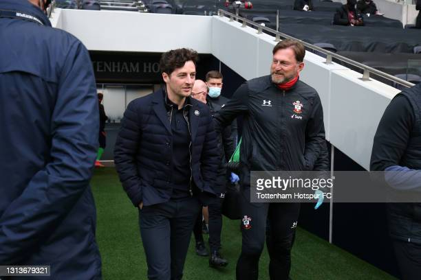 Ryan Mason, Interim Manager of Tottenham Hotspur interacts with Ralph Hasenhuettl, Manager of Southampton prior to the Premier League match between...