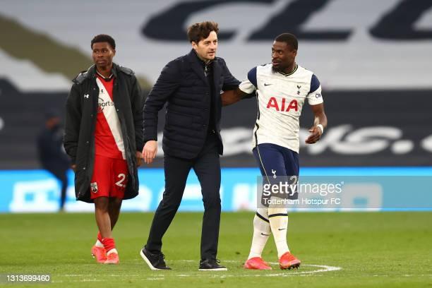 Ryan Mason, Interim Manager of Tottenham Hotspur interacts with Serge Aurier of Tottenham Hotspur after the Premier League match between Tottenham...