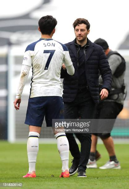 Ryan Mason, Interim Manager of Tottenham Hotspur shakes hands with Son Heung-Min of Tottenham Hotspur following victory in the Premier League match...
