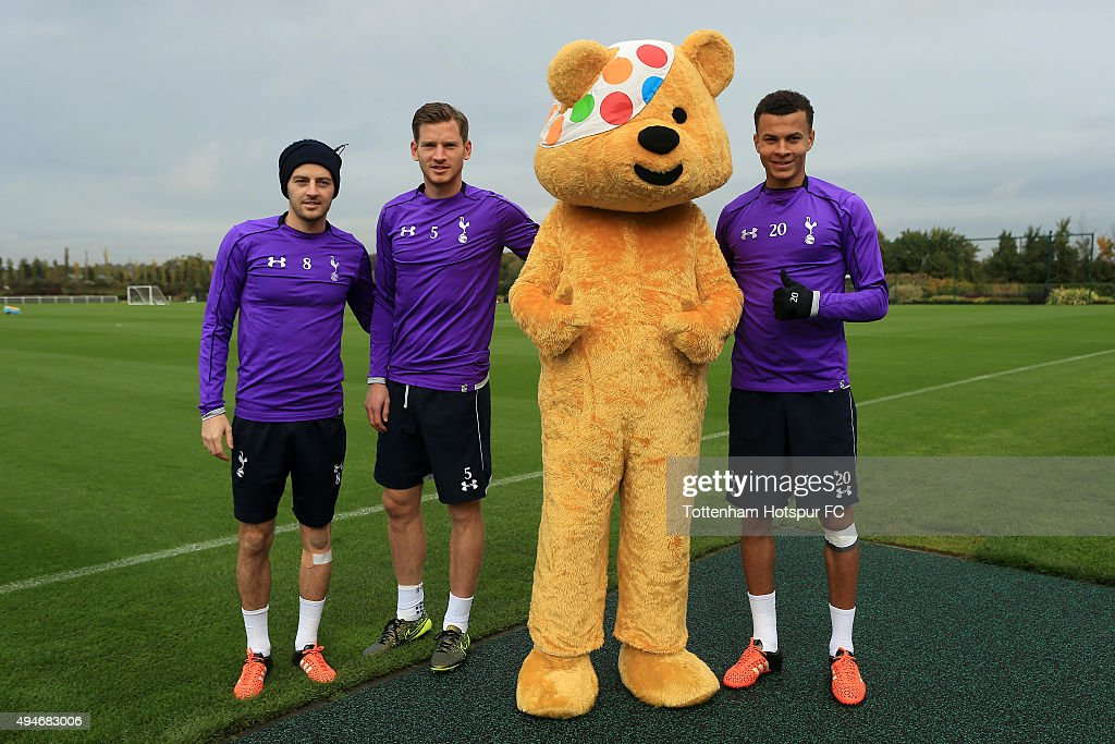 Ryan Mason, Jan Vertonghen and Dele Alli of Tottenham Hotspur meet Children In Need's Pudsey Bear at the club's training ground on October 28, 2015 in Enfield, England.