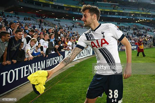 Ryan Mason of Hotspur throws his training jersey into the crowd following the international friendly match between Sydney FC and Tottenham Spurs at...