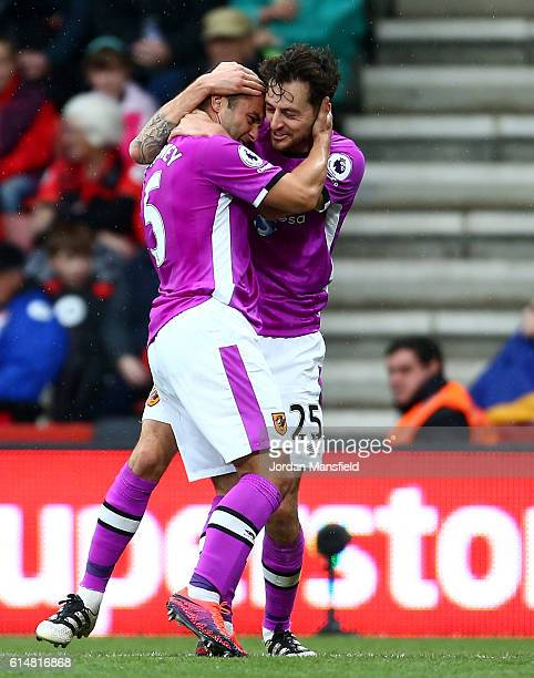 Ryan Mason of Hull City celebrates scoring his sides first goal with his team mate Shaun Maloney of Hull City during the Premier League match between...