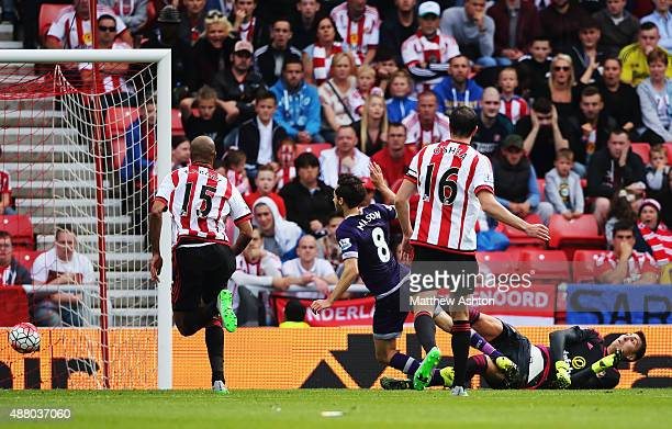 Ryan Mason of Tottenham Hotspur beats goalkeeper Costel Pantilimon of Sunderland to score their first goal during the Barclays Premier League match...