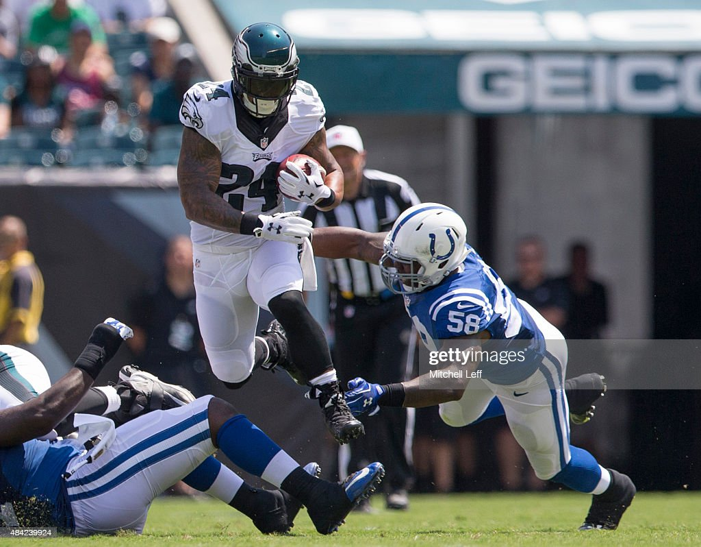 Ryan Mathews #24 of the Philadelphia Eagles avoids the tackle by Trent Cole #58 of the Indianapolis Colts in the first quarter of their preseason game on August 16, 2015 at Lincoln Financial Field in Philadelphia, Pennsylvania. The Eagles defeated the Colts 36-10.