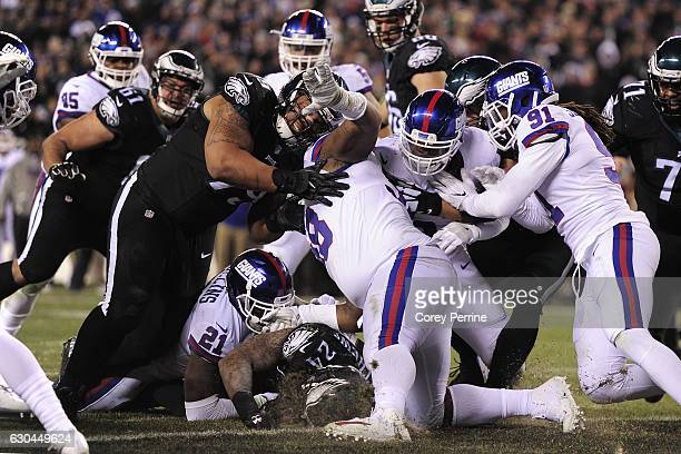 Ryan Mathews of the Philadelphia Eagles can't punch in a goal line touchdown against Landon Collins of the New York Giants during the third quarter...