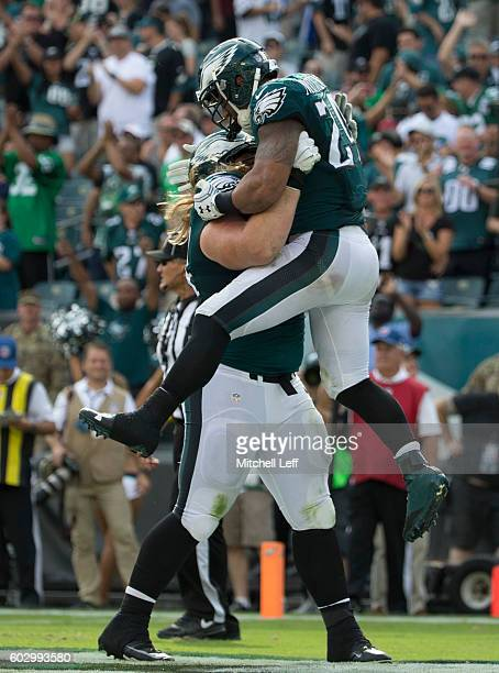 Ryan Mathews of the Philadelphia Eagles celebrates with Beau Allen after scoring a touchdown in the fourth quarter against the Cleveland Browns at...