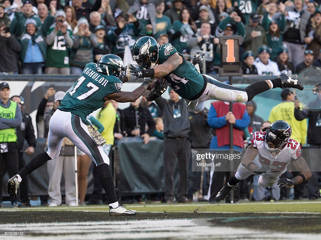 Ryan Mathews #24 of the Philadelphia Eagles jumps over Robert Alford #23 of the Atlanta Falcons to score a touchdown as Nelson Agholor #17 tries to catch him in the fourth quarter at Lincoln Financial Field on November 13, 2016 in Philadelphia, Pennsylvania. The Eagles defeated the Falcons 24-15.