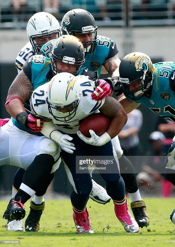 Ryan Mathews #24 of the San Diego Chargers is tackled during the game against the Jacksonville Jaguars at EverBank Field on October 20, 2013 in Jacksonville, Florida.