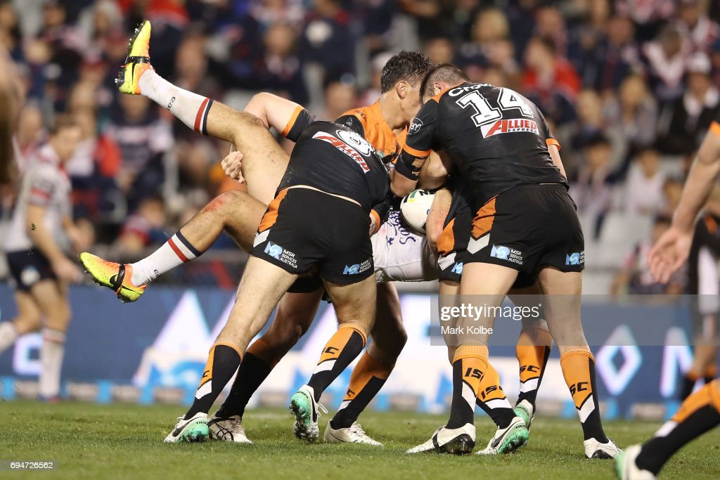 Ryan Matterson of the Roosters is tackled during the round 14 NRL match between between the Wests Tigers and the Sydney Roosters at Campbelltown Sports Stadium on June 11, 2017 in Sydney, Australia.
