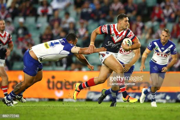 Ryan Matterson of the Roosters runs the ball during the round two NRL match between the Sydney Roosters and the Canterbury Bulldogs at Allianz...