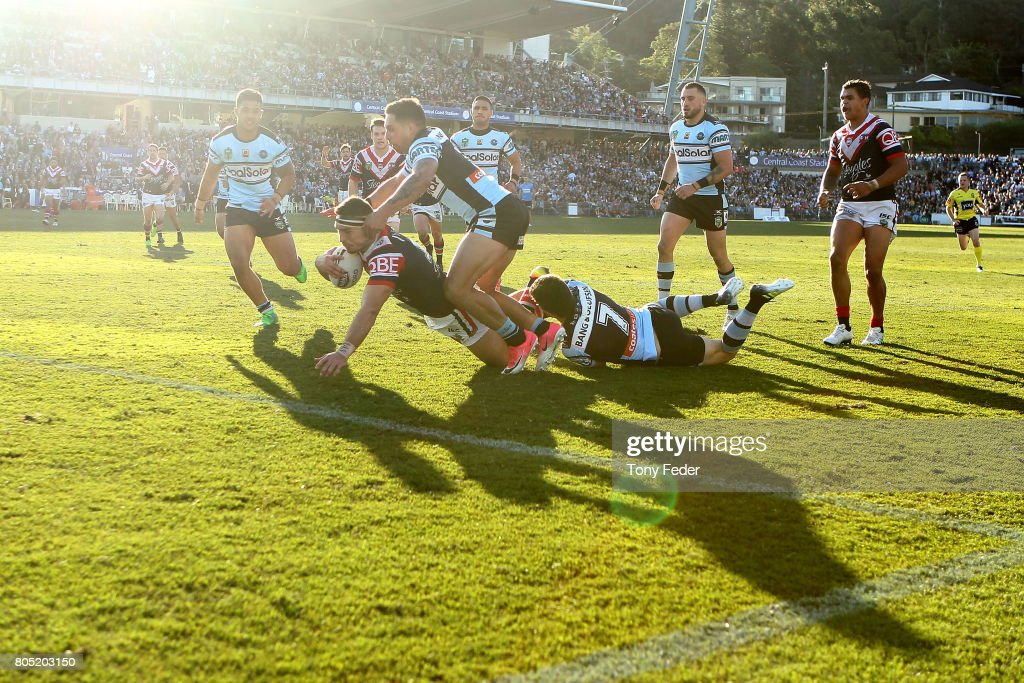 Ryan Matterson of the Roosters scores a try during the round 17 NRL match between the Sydney Roosters and the Cronulla Sharks at Central Coast Stadium on July 1, 2017 in Gosford, Australia.