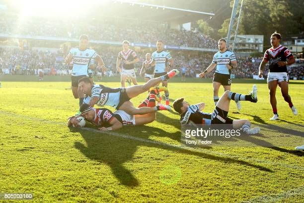Ryan Matterson of the Roosters scores a try during the round 17 NRL match between the Sydney Roosters and the Cronulla Sharks at Central Coast...