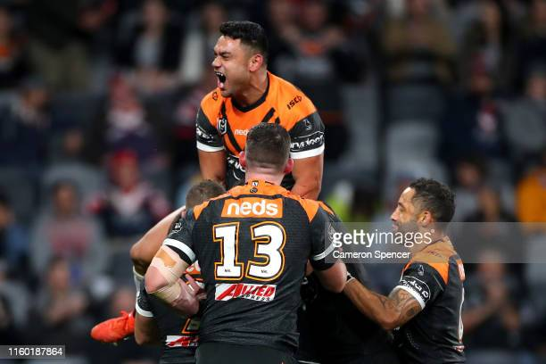 Ryan Matterson of the Tigers celebrates scoring a try during the round 16 NRL match between the Wests Tigers and the Sydney Roosters at Bankwest...